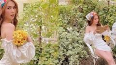 Ngọc Trinh tựa thiên thần quyến rũ trong vườn hoa lá với set đồ trắng gợi cảm
