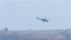 Lính Mỹ rút lui khi Nga điều Mi-35 tới điểm xung đột