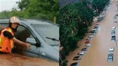 Hàng dài ô tô chìm nghỉm trong mưa lũ ở Trung Quốc