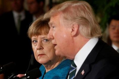 Thủ tướng Đức Angela Merkel và Tổng thống Donald Trump tổ chức một cuộc họp báo chung tại Nhà Trắng vào ngày 17/3/2017. Ảnh: Reuters