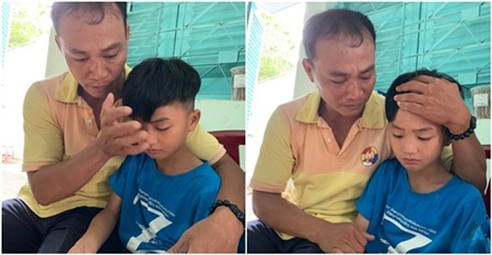 Người cha ôm chặt lấy con trai, không giấu nổi niềm hạnh phúc khi được đoàn tụ.