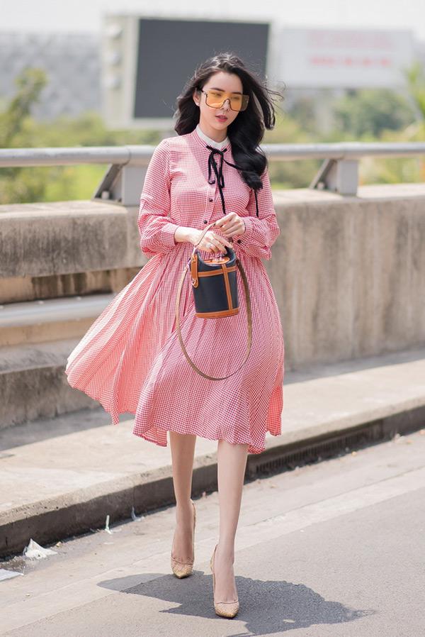 Ngắm phong cách thời trang từ 'ngoan hiền' đến cực sexy của Hoa hậu Huỳnh Vy 10