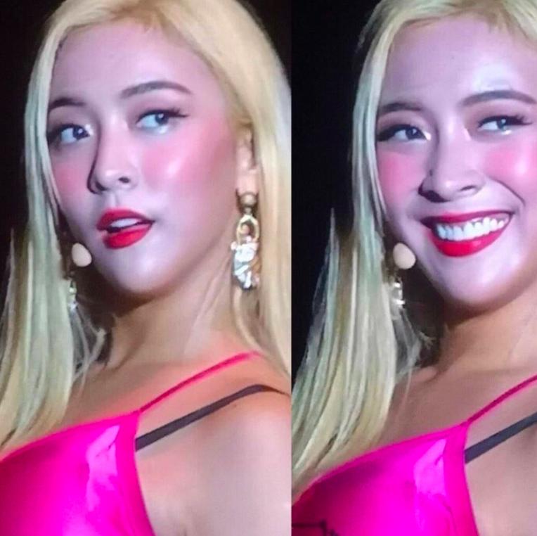 Phong cách trang điểm khó hiểu cùng chiếc áo hai dây lụa màu hồng sến súa của Luna đêm 21/09