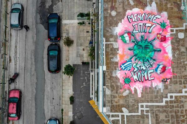 Loạttác phẩm nghệ thuật đường phố tuyên truyền phòng chống đại dịch Covid-19 ấn tượng trên thế giới 6