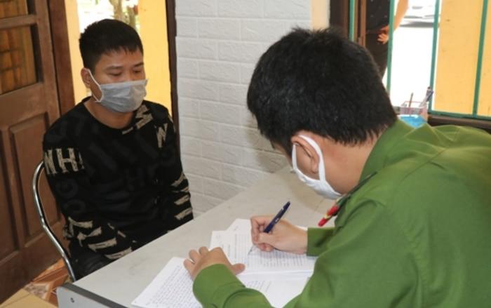 Lê Quang Huy tại cơ quan công an.