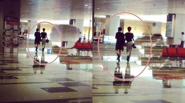 Hình ảnh Đào Bá Lộc sánh vai bên người đàn ông tên T tại sân bay Singapore.