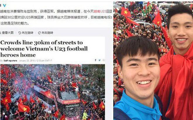Chặng đường 30km được nhuộm đỏ bởi cờ hoa chào đón những người hùng trở về khiến Trung Quốc sửng sốt