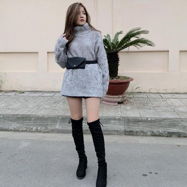 An Japan diện đồ theo mốt giấu quần, khoe khéo chân thon khi mix áo len dáng dài cùng boots cao quá gối.