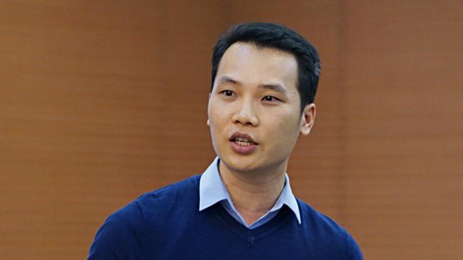Tiến sĩ Nguyễn Xuân Thủy, Học viện Cảnh sát nhân dân, nêu đề xuất tại hội nghị. Ảnh Lê Hiệp.