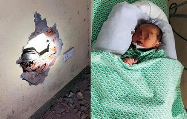 Thời điểm mới phát hiện cháu bé trong khe tường, người dân đã phải đục tường để giải cứu. Ảnh: shoha.vn