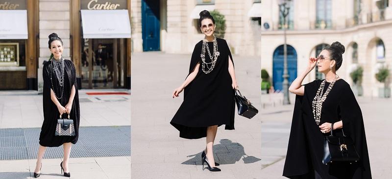 Yêu thích phong cách đơn giản, thanh lịch, người đẹp Diễm Mỹ diện chiếc váy cape tông đen rất sang trọng. Hoa hậu 'không tuổi' đã tạo điểm nhấn bằng cách kết hợp chuỗi vòng cổ ngọc trai Chanel cùng loạt phụ kiện hàng hiệu khác như nhẫn to bản và kính râm Celine, xách túi gam màu đồng điệu của Delvaux.