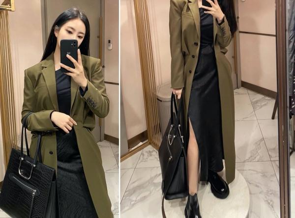 Hyomin chứng minh gu thẩm mỹ 'chất lượng 100 điểm' của mình khi 'mạnh tay' phối trench coat dài và kiểu váy màu đen trơn dài có xẻ tà cao. 2 items tưởng như không liên quan đến nhau nhưng khi được kết hợp lại 'nịnh mắt' bất ngờ.