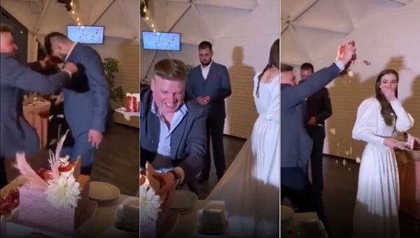 Vị khách trong cơn say đã lao về phía bánh cưới và cố gắng trét bánh vào cô dâu, chú rể