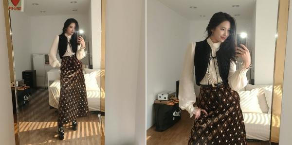 Với những set đồ được mix theo kiểu layering ấn tượng, Sunmi chứng minh mình xứng đáng được gọi là fashionista nổi bật trong giới showbiz Hàn. Set đồ của cô được phối bởi áo blouse bèo nhún, gile buộc dây và chân váy họa tiết.