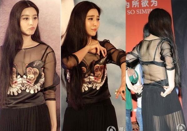 Không chỉ diện một thiết kế áo xuyên thấu lộ dấu vết nội y, Phạm Băng Băng còn tiện tay chỉnh lại dây áo ngay khi có sự cố. Thậm chí cô còn chẳng cần đi vào trong cánh gà mà làm luôn trên sân khấu trước hàng nghìn ảnh mắt.