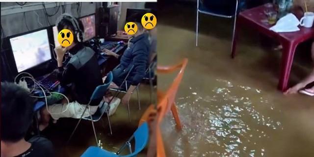 Hình ảnh trong đoạn clip ghi lại cảnh một nhóm game thủ vẫn 'bình tĩnh' chơi game bất chấp nước dâng cao