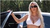 Kim Kardashian diện nội y khó hiểu thả dáng bên cạnh siêu xe