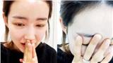 Nữ thần tượng Kpop bật khóc, chắp tay cầu xin sau khi để lộ số điện thoại thành viên chung nhóm trên livestream