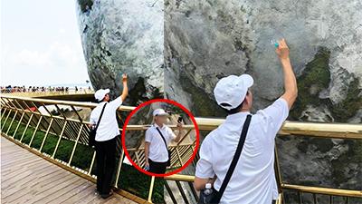 Chia sẻ ảnh người đàn ông vô ý thức trên Cầu Vàng, chủ nhân loạt ảnh bất ngờ 'hứng đạn'