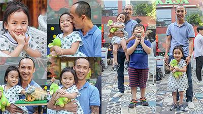 Một năm được cưu mang, em bé Mường Lát ngày nào đã khỏe mạnh, tươi cười cùng bố nuôi khám phá Sài Gòn