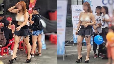 HN ngày nóng chảy mỡ, chị gái trên phố đi bộ khiến dân tình ná thở khi diện váy ngắn cỡn + áo ngực hở hang