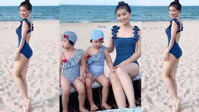 Danh tính 'bà mẹ bỉm sữa' nóng bỏng chơi đùa cùng 2 con gái bên bờ biển: Là giảng viên Báo chí