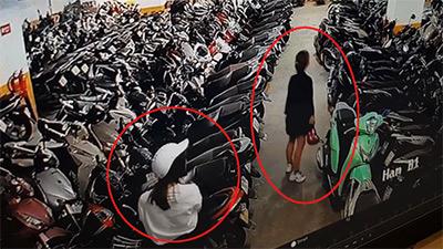 Clip: Nghi vấn 2 cô gái trẻ trộm mũ bảo hiểm dưới hầm gửi xe khiến người xem xôn xao bàn tán
