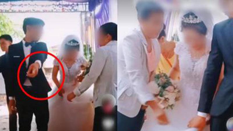 Chú rể to tiếng quát mắng người phụ nữ có tuổi trong hôn lễ, không thèm cầm váy giúp vợ và thái độ thật khó tin của cô dâu