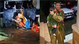 Khoảnh khắc xúc động: Chiến sĩ ủ ấm cho bé trai vừa được giải cứu khỏi xe khách bị cuốn trôi tại Quảng Bình