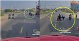 CLIP: Xe container từ phía sau lao đến, bấm còi inh ỏi, vợ cuống cuồng nhảy khỏi xe chồng thoát thân