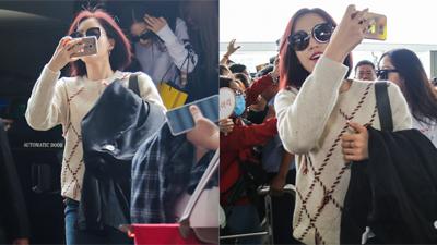 Eun Jung (T-ara) hào hứng dùng điện thoại ghi hình fan tại sân bay trước khi trở về Hàn