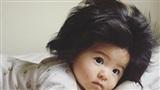 Cô bé 6 tháng tuổi với mái tóc bồng bềnh đốn tim cư dân mạng