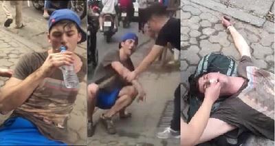 Clip thanh niên Tây say thuốc lào, vạ vật lăn lộn trên phố Hà Nội