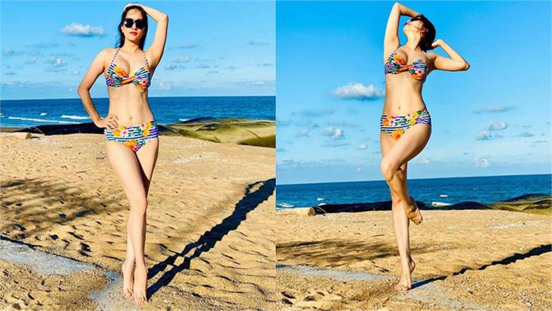 Khánh Thi diện bikini khoe dáng giữa biển, 'đốt mắt' người nhìn với 3 vòng nóng bỏng