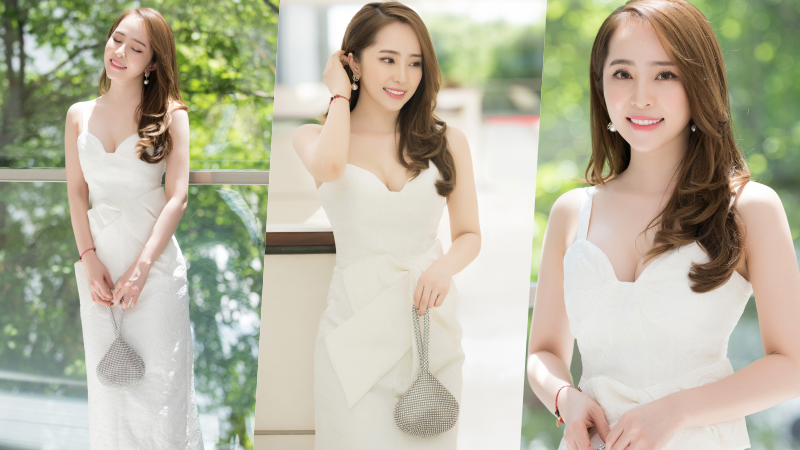 Quỳnh Nga mặc váy trắng muốt tiểu thư, xách túi giọt nước lạ mắt đi sự kiện