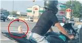 Anh chàng hổ báo chạy xe phân khối lớn chở theo sau một cô nàng bánh bèo, dân mạng người ngã ngửa kẻ giật mình với những nguyên nhân được đồn đoán