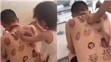 Ông bố của năm: Dùng tấm lưng trần của mình cho con gái tập vẽ
