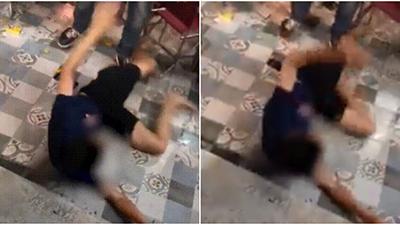 Hoang mang trước clip nam thanh niên nằm lăn ra đất, giãy giụa giữa quán nước ở Hà Nội