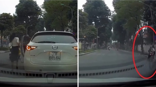 Nữ tài xế ra hiệu dừng xe giữa ngã tư, hành động sau đó của chị khiến MXH Việt rần rần khen ngợi