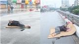 Tranh thủ Hà Nội vắng người, thanh niên mang chiếu trải ra đường để nằm, bất ngờ trước phản ứng của cư dân mạng