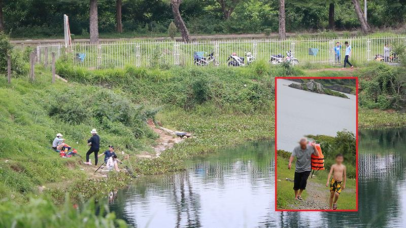 Mặc cảnh báo nguy hiểm, nhiều người vẫn 'hồn nhiên' câu cá, tập bơi tại hồ Đá 'tử thần'