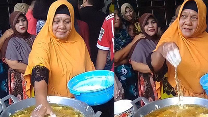 Dân mạng xém xỉu khi chứng kiến 'người đàn bà thép' nhúng cả tay vào chảo dầu sôi, luyện bao lâu để đạt trình độ này?