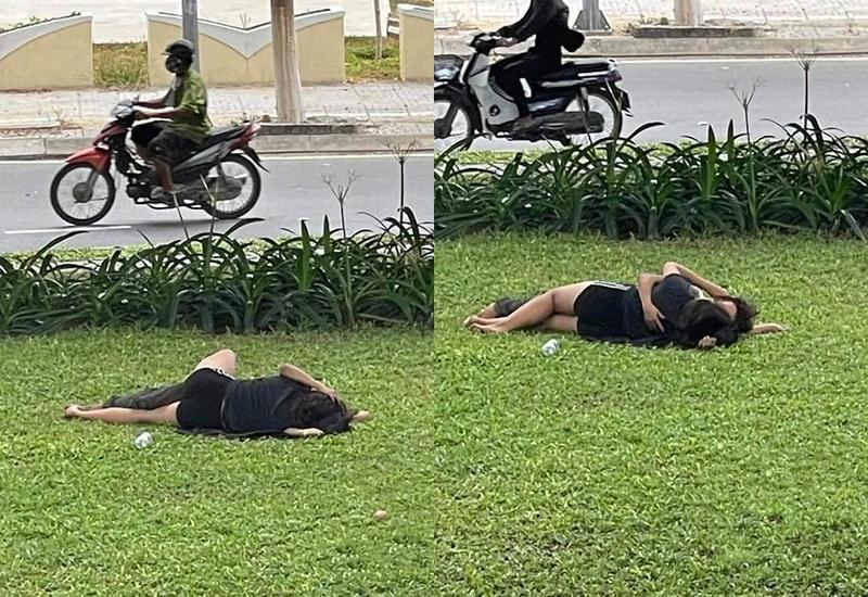 Cặp đôi thản nhiên nằm ôm hôn nhau giữa bãi cỏ...